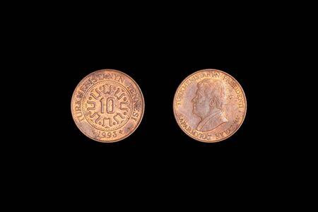 coin ten Tennesi, Turkmenistan, 1993 on a black background