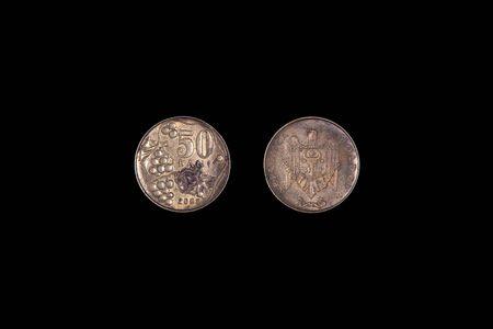 Moldovan coin bani. Aged metal. black background, close-up