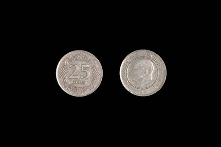 25 Turkish kurus coin, 2009, both sides. Black background, close-up. Stock Photo