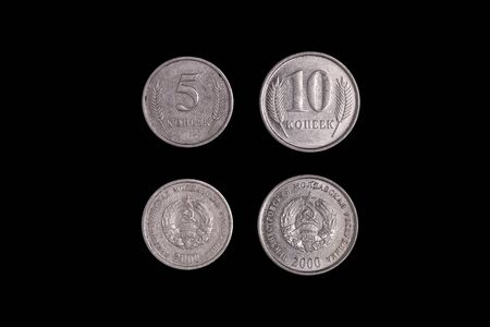 five and ten kopecks, Republica Moldova on a black background
