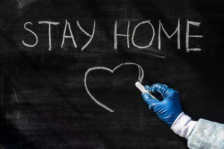 Coronavirus pandemic behaviour rules or health advice - stay at home. Stay at Home. Stay at Home chalkboard inscription.