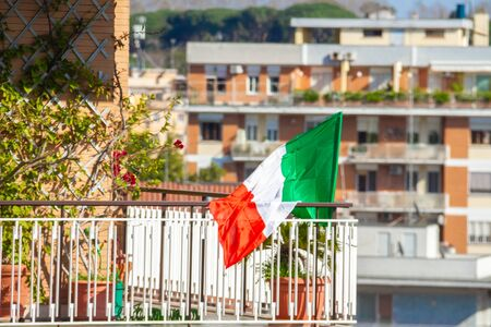 italian flag on the balcony. Coronavirus. Epidemic. Patriotic. Everything will be good. Support for doctors
