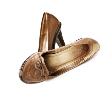 two object: Shabby womans brown Leather shoes with bows