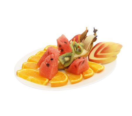 Assorted fruits on a plate isolated on a white background photo
