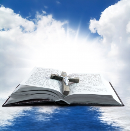 Prayer Holy book on the background of clouds and sun photo