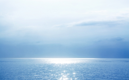 Beautiful Blue Seascape With The Sun Glittering Water photo