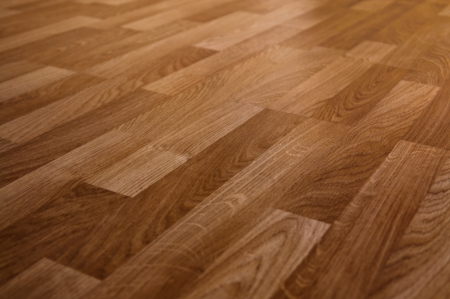 The floor of the light brown laminate diagonally photo