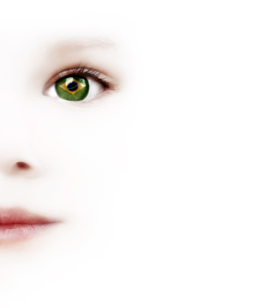 one eye: Smiling Childs Face And One Eye With The Brazilian Flag On A White Background