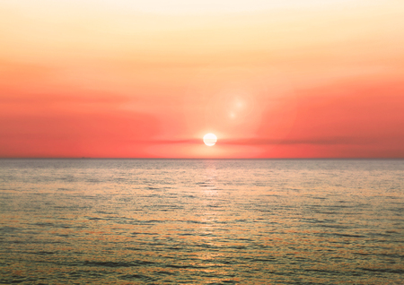 Beautiful blazing sunset landscape on a sea and sun