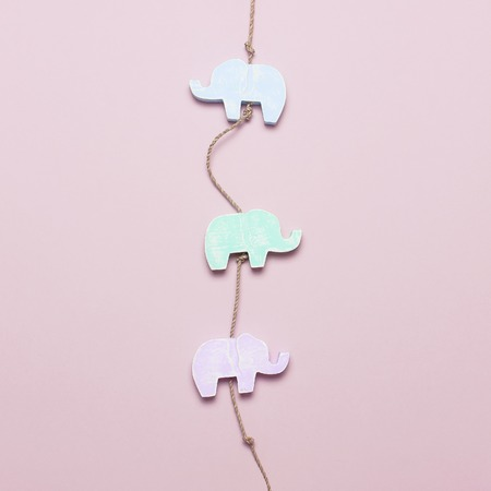 Multi-colored childrens wooden toys in the form of elephants and whales. Organic Natural Toys for Children and Babies, handmade toy
