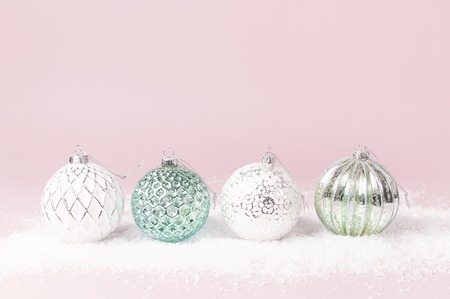 Vintage Christmas New Year balls in the snow on pink background Flat Lay copy space. Holiday Baubles, beautiful Decoration Festive decor celebration Xmas holiday greeting card