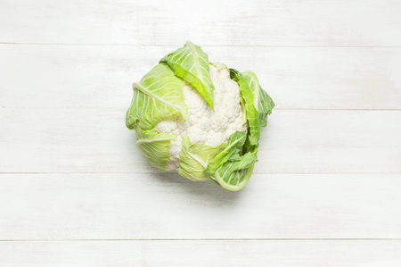 Fresh raw cauliflower on rustic white wooden background top view flat lay copy space. Cooking, healthy wholesome food, vegetable, diet concept Archivio Fotografico