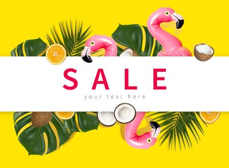 Creative concept of summer sales. Inflatable pink mini flamingo tropical palm leaf monstera coconut orange on yellow background pool float party. Flat lay Flamingo Trend Inflatable Toy Discounts sale.
