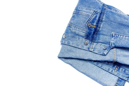 Close-up Blue denim jacket on isolated white background top view flat lay copy space. Denim, fashionable jacket, women's or men's trend clothing, fashion background. Store concept, sale. Stockfoto