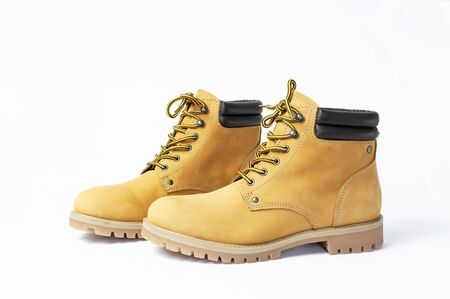 Yellow men's work boots from natural nubuck leather isolated on white background. Trendy casual shoes, youth style. Concept of advertising autumn winter shoes, sale, shop.