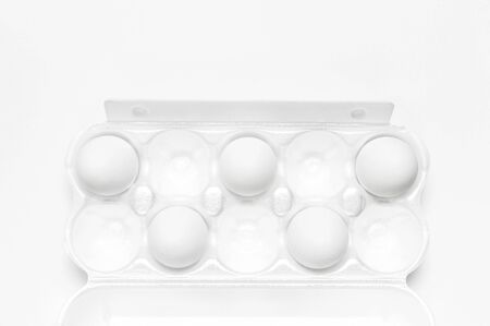 White chicken eggs in white packaging on light background top view flat lay copy space. Eggs in box, natural healthy food and organic farming concept. Creative food minimalistic background, Easter. 스톡 콘텐츠