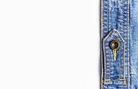 Close-up Blue denim jacket on isolated white background top view flat lay copy space. Denim, fashionable jacket, women's or men's trend clothing, fashion background. Denim texture.