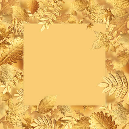 Autumn creative composition. Golden flying autumn leaves and beige blank sheet of paper on beige gold background. Autumn concept, fall background. Minimal floral design, autumn leaf frame Golden twig