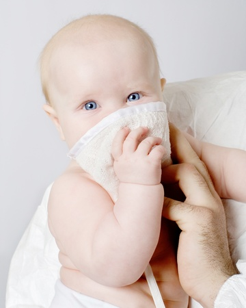 The baby uses a means of individual protection photo