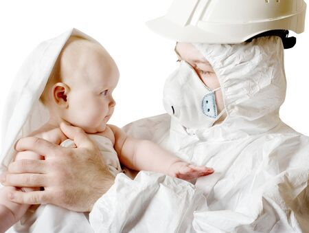 The man in protective clothes and a respirator holds the baby on hands photo