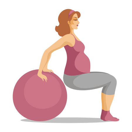 fitball: the young beautiful pregnant woman does gymnastics with a fitball