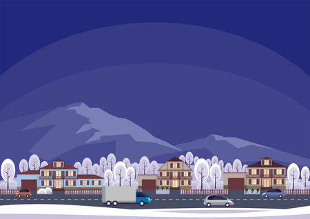 townscape: The cottage settlement against the background of mountains. Winter landscape