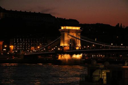 Budapest, Hungary - Beautiful Szechenyi Chain Bridge with sightseeing boat on River Danube 写真素材