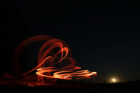 Starry sky and drawings with fire and lanterns long exposure, natural landscape, Ukraine
