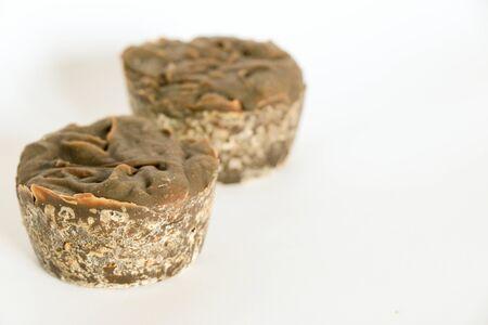Bars of natural, handmade organic soap on white background