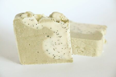 Bars of natural organic soap on white background. Handmade soap making. Spa products and skin care concept.
