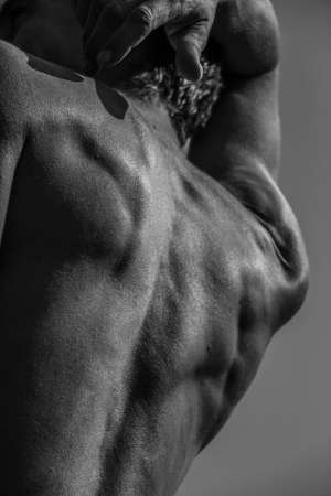 Black and white image of a muscular man, athletic body, handsome masculine muscle shapes, relief. Beautiful strong and flexible body, sexy attractive. Banco de Imagens