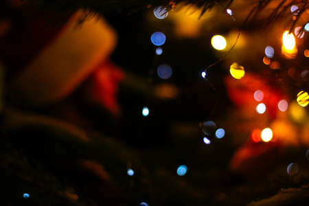 Christmas tree with gold defocused lights and silhouette of spruce branch. defocused new year background with space for text 版權商用圖片 - 159600252