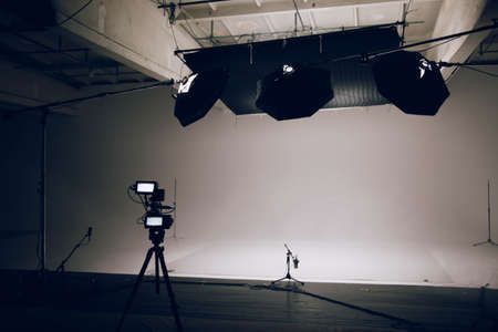 The interior of a large modern video studio with professional equipment prepared for work. Camera in the foreground Zdjęcie Seryjne