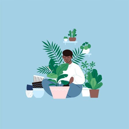A person staying home planting a banana tree. A room full of plants.