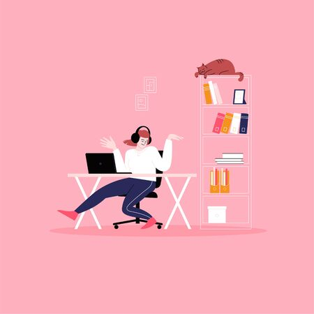 Young woman dancing while sitting at the desk. Having fun at work. Work from home concept