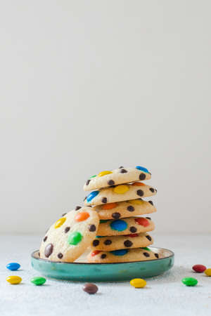 Homemade m&m's cookies on white table.