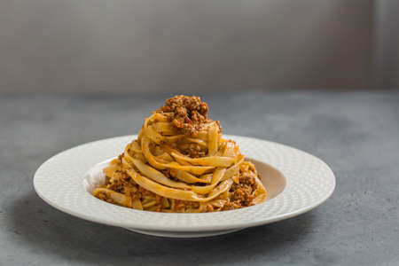 Tagliatelle al rag alla Bolognese - long, flat egg pasta with a meat sauce or Bolognese sauce.