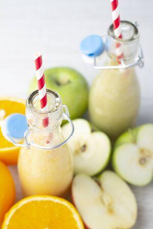 fruit smoothies on white background closeup