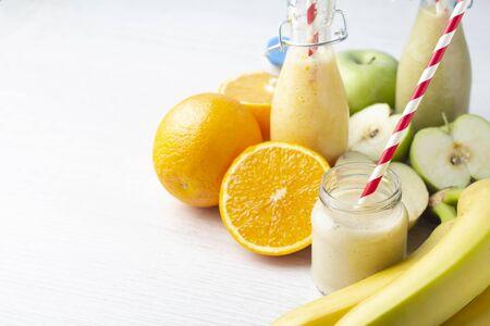 fruit smoothies on white background