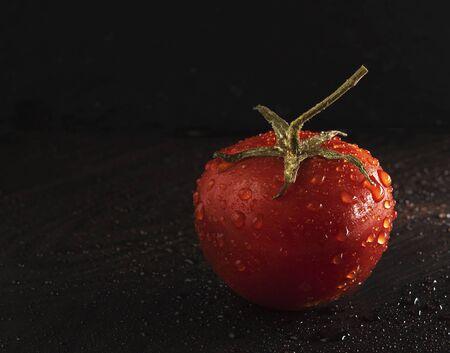 alone tomato cherry dark background control light wet macro close up red Stock Photo