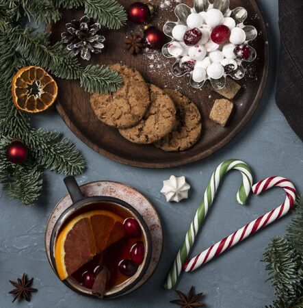 christmas still life flat lay  cookies cup of tea christmas tree new year mood top view