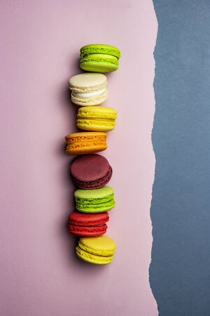some colored macaroons top view colorful straight line pink gray background art of food