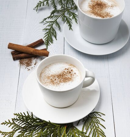 two cup of hot chocolate with cinnamon christmas  tree  white wood background new year mood  rustic Reklamní fotografie
