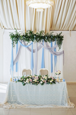 Wedding decorations with colorful flowers, napkins, tapes and table design