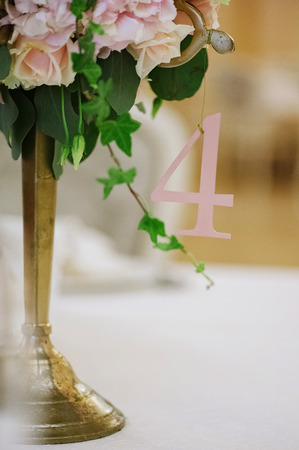 Guest tables with candlestick and number of this table