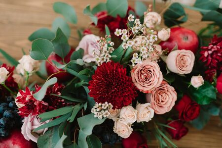 pomergranate: Autumnal wedding bouquet of roses, apples, grape and pomergranate