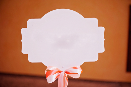 Accessory, white nameboard with nice small bow Stock Photo
