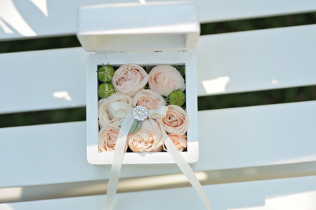 Wedding gift casket decorated with bow and buds
