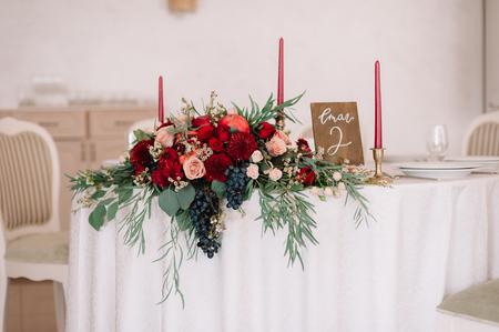 Glorious autumn bouquet on guest wedding table