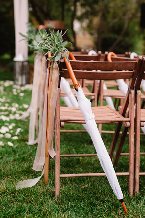 Wedding chairs on each side of archway